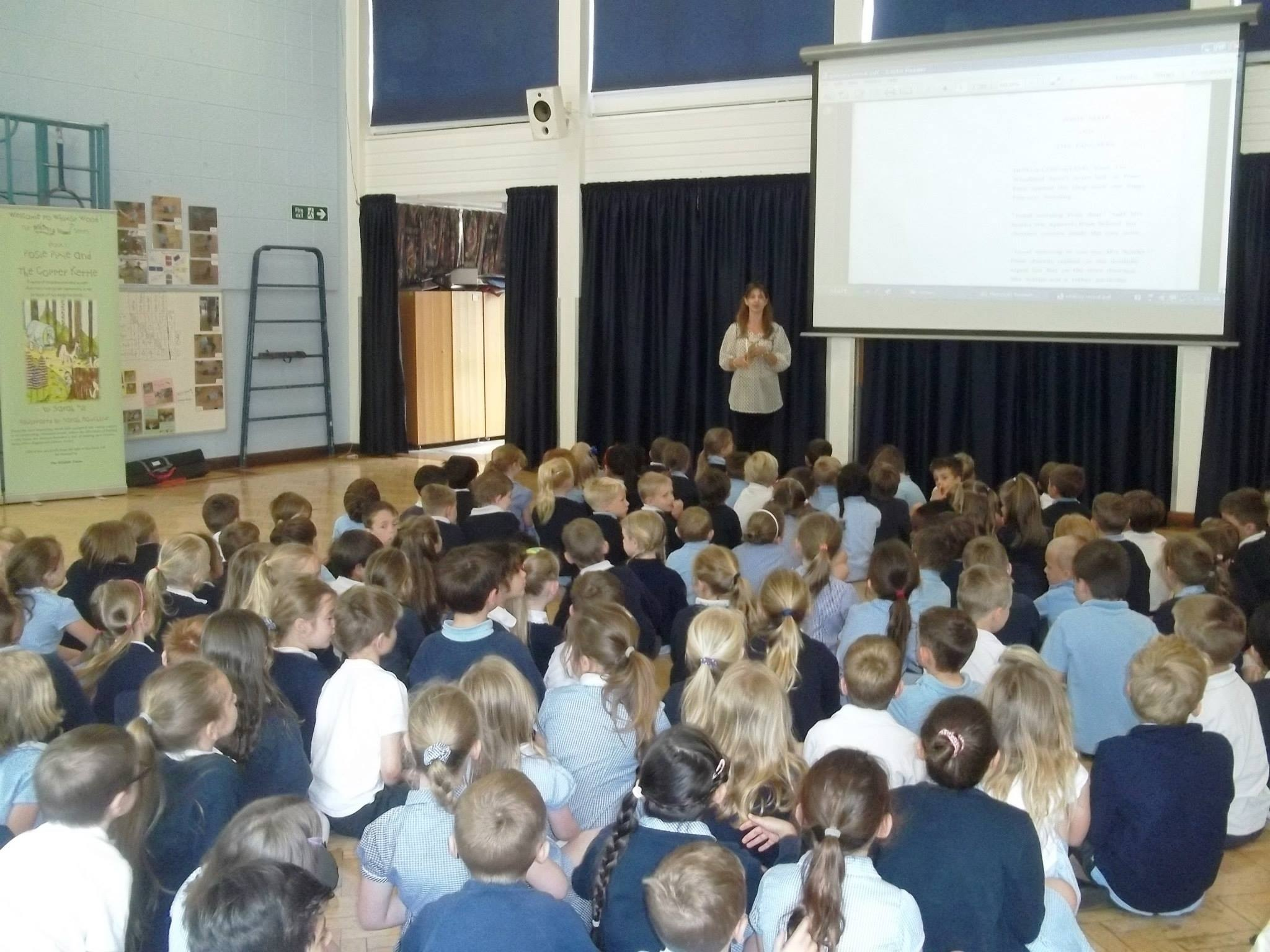 Reading 'Posie Pixie And The Pancakes' to the KS1 children at Knebworth Primary ?