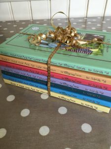 The 1st set of 7 Whimsy Wood hardbacks ready to be donated to local libraries.